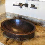 Oval Skirted Vessel Hammered Copper Sink